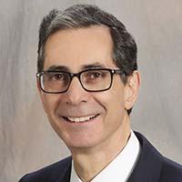 Dr. Eric M.  Friedman